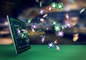 żetony do pokera wylatujące z ekranu tableta