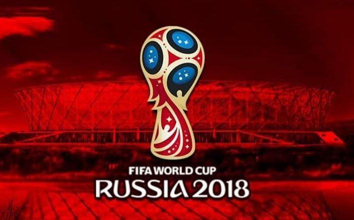 Logo MŚ 2018 w Rosji na tle stadionu piłkarskiego